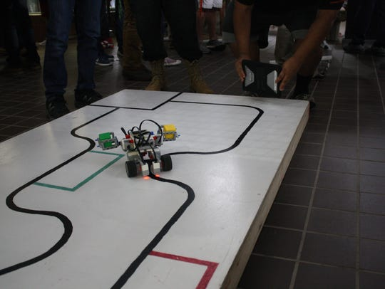 A robot competes in a line following challenge Wednesday