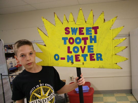 "Fifth-grader Alex Medovich, 10, shows off a ""Sweet"