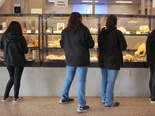 Kirtland Middle School eighth-grade students participate in a scavenger hunt on May 7 in the Sherman Dugan Museum of Geology at San Juan College.