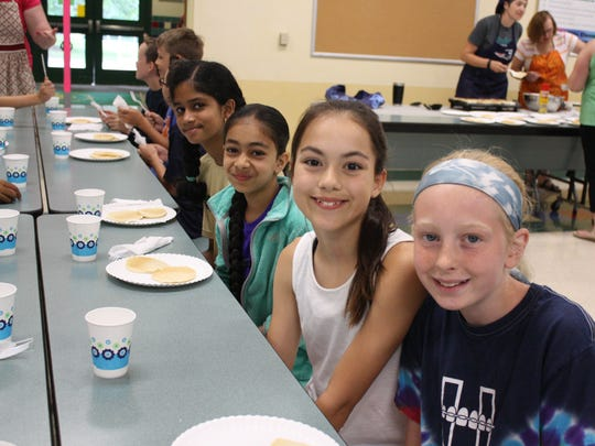 Students at Vestal Hills Elementary School celebrated the last day by eating pancakes cooked by their teachers Wednesday morning.