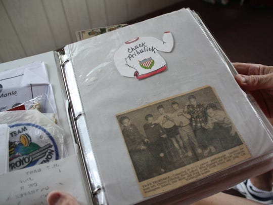 Chuck Pribulick, 75, of Endicott, keeps a scrapbook of memories of his 65 years of yo-yoing.,