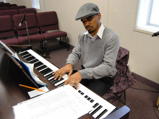 The Rev. Tray Smith plays keyboards at Faith Christian Community Church in Port Huron.