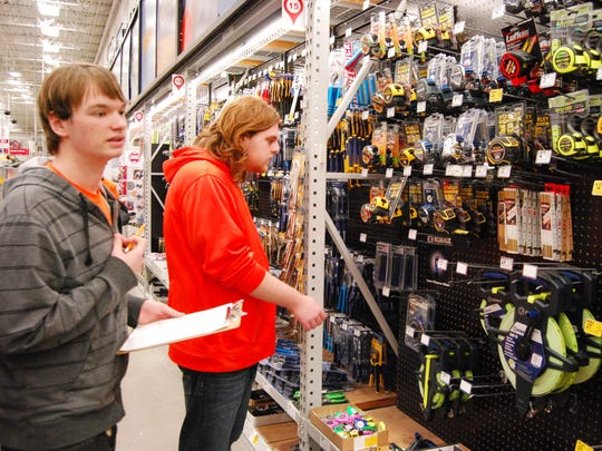 Marysville High School juniors Michael Dupuie, left, and Logan True seem overwhelmed by the variety of hand tools at the Lowe's Home Improvement store in Fort Gratiot.