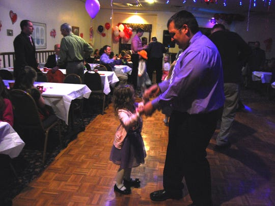 Jeff Mullins, of St. Clair, dances with his daughter, Brea, 4, during a Daddy-Daughter Valentine's Dance in St. Clair.