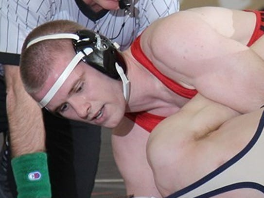 Trevor Meyers, top, wrestles his opponent from Thiel