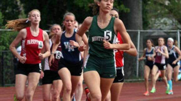 Cassandra Harasts of Montville (right) competes at the Morris County Championships last spring. Photo by Bob Karp/Staff Photographer.