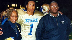 The biggest boosters at football games for Holy Angels High School in Minneapolis in 2000 were Larry Fitzgerald Jr.'s father, Larry Sr., and his mother, Carol, who died in early 2003.