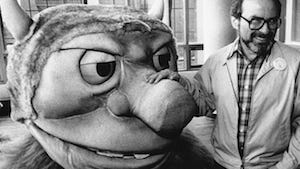 """In this AP file photo from Sept. 25, 1985, author Maurice Sendak poses with one of the characters from his book """"Where the Wild Things Are."""""""