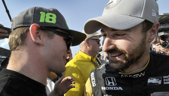 IndyCar driver James Hinchcliffe (5) celebrates with his friend Conor Daly,left, winning the pole position100th running of the Indianapolis 500 on Armed Forces Pole Day Sunday, May 22, 2016, afternoon at the Indianapolis Motor Speedway.