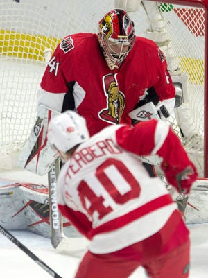 Detroit Red Wings left wing Henrik Zetterberg shoots on Ottawa Senators goalie Craig Anderson in Ottawa, Ontario,  on Feb. 20, 2016.