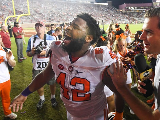 Clemson defensive lineman Christian Wilkins (42) celebrate the Tigers 37-34 win over Florida State on Oct. 29 at Doak Campbell Stadium in Tallahassee, Florida.