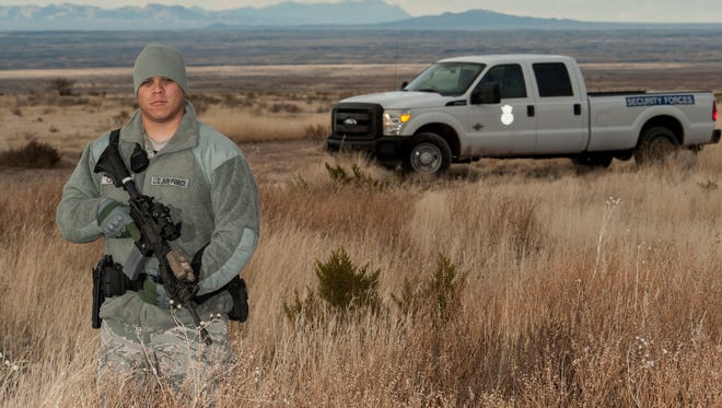 Staff Sgt. Aaron Calzada, a Security Forces team leader, stands guard at an F-16 crash scene Northwest of Salinas Peak, New Mexico, Nov. 26. Security Forces was one of several agencies to arrive in the first wave of responders following the F-16 crash. The crash site is currently under investigation.