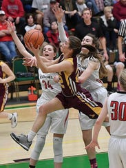 Belt's Dani Urick drives to the hoop during the State