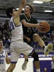 Howell's Luke Russo drives to the basket against Kabir