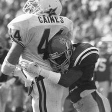 Ole Miss defensive back Chucky Mullins hits Vanderbilt tight end Brad Gaines during a 1989 game in Oxford. The hit paralyzed Mullins.