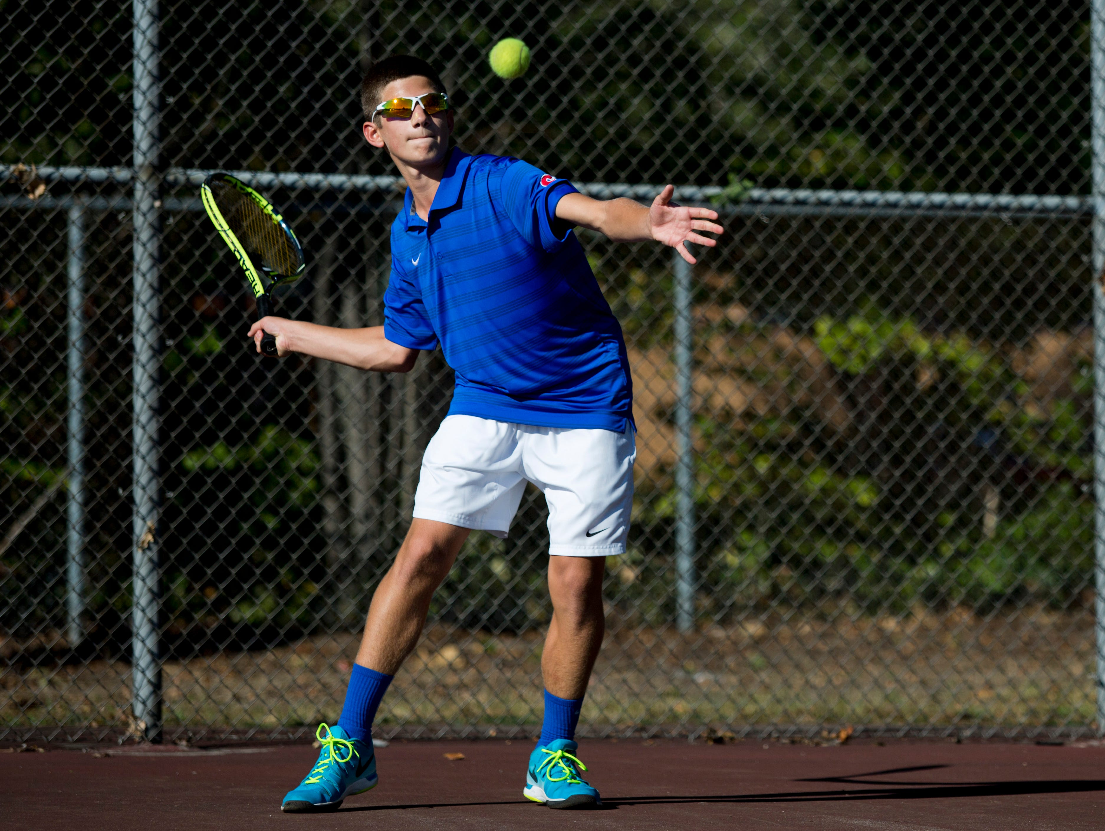 St. Clair sophomore Troy Distelrath returns the ball during a tennis match Wednesday, September 23, 2015 at Port Huron Northern High School.