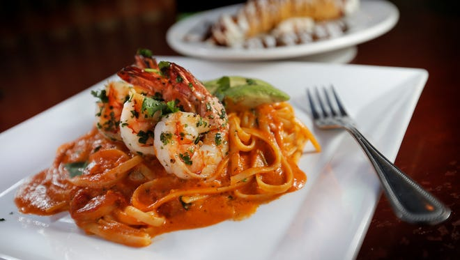 The Mario Special from Trattorria Bella Sera, 9449 Montana, features linguini tossed with a spicy, creamy tomato sauce, red bell peppers and a dash of lime, and topped with grilled tiger shrimp and avocado.