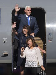Mike Pence (top), with wife Karen and daughter Charlotte, greet well-wishers at a homecoming rally at the Indianapolis Executive Airport for Pence, who is the running mate of presumptive GOP Presidential nominee Donald Trump, Zionsville, Saturday, July 16, 2016.
