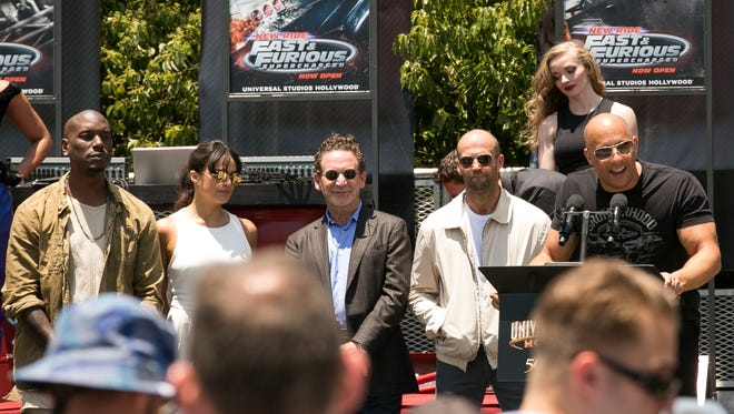 """Vin Diesel, right, speaks at the World Premiere of the """"Fast & Furious-Supercharged"""" ride at Universal Studios Hollywood on Tuesday, June 23, 2015, in Universal City, Calif."""