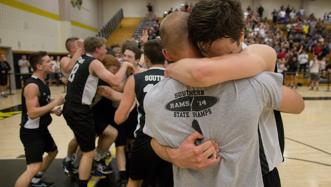 Southern's Liam Maxwell hugs one of his coaches as his team celebrates their victory in the NJSIAA State Boys Volleyball final at South Brunswick on June 9, 2016.