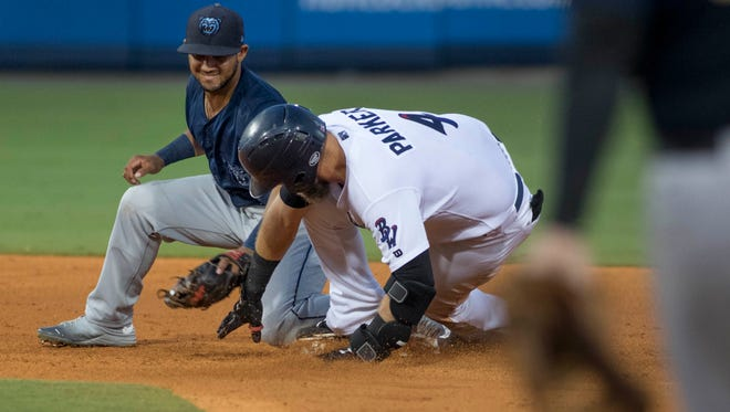 Kyle Parker (4) stretches his hit into a double when the original throw went to third base during the Mobile BayBears vs. Blue Wahoos baseball game one of a double header at Blue Wahoos Stadium in Pensacola, FL on Thursday, June 16, 2016.