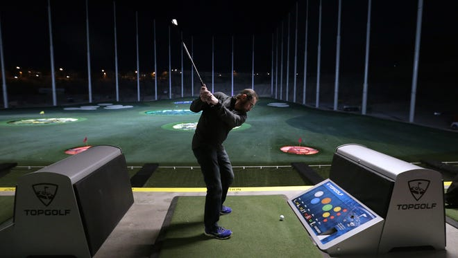 Darrel Petry tees off Jan. 24, during the preview party at Topgolf El Paso, located at 365 Vin Rambla Drive in the Montecillo Smart Growth Community in West El Paso.