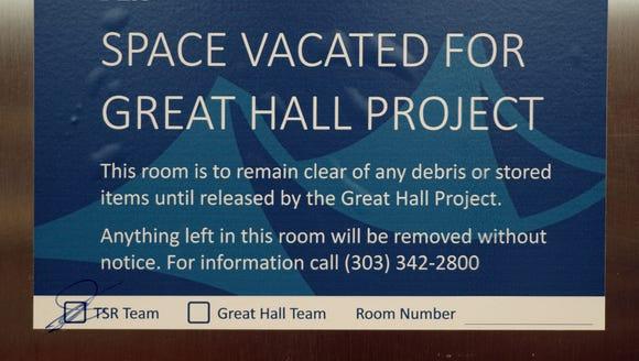 A sign alerts travelers to a closure at Denver International