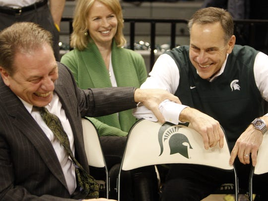 Michigan State head coach tom Izzo and head football coach Mark Dantonio before the game against Michigan Tuesday, Feb.12, 2013, at the Breslin Center in East Lansing.