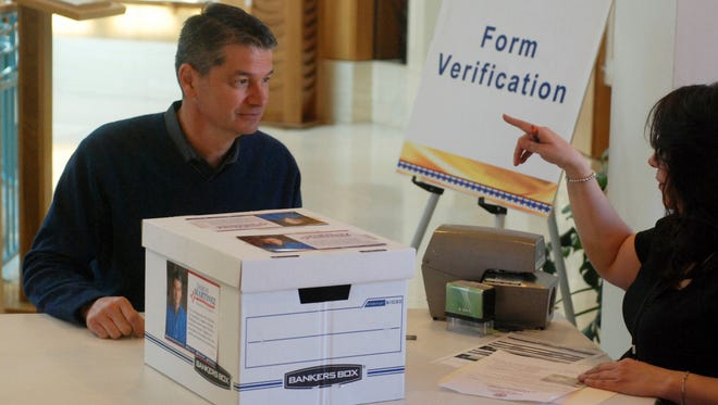 Former U.S. Attorney Damon Martinez of Albuquerque registers to run for statewide office at the New Mexico Secretary of State's Office in Santa Fe on, Feb. 6, 2018, as states gear up for 2018 elections.
