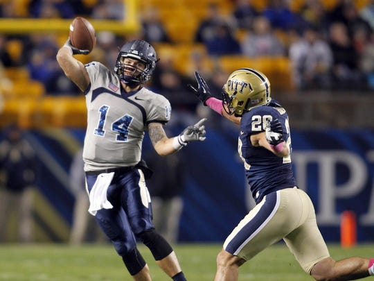 Old Dominion quarterback Taylor Heinicke (14) played with MTSU running back Jordan Parker in high school in Georgie.