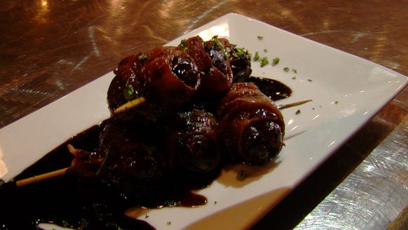 The Bacon-wrapped date at Toro Lounge.