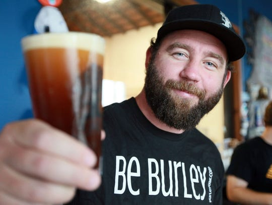 Owner of Burley Oak Brewery, Bryan Brushmiller, holds