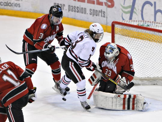 The puck skips under St. Cloud State's David Morley