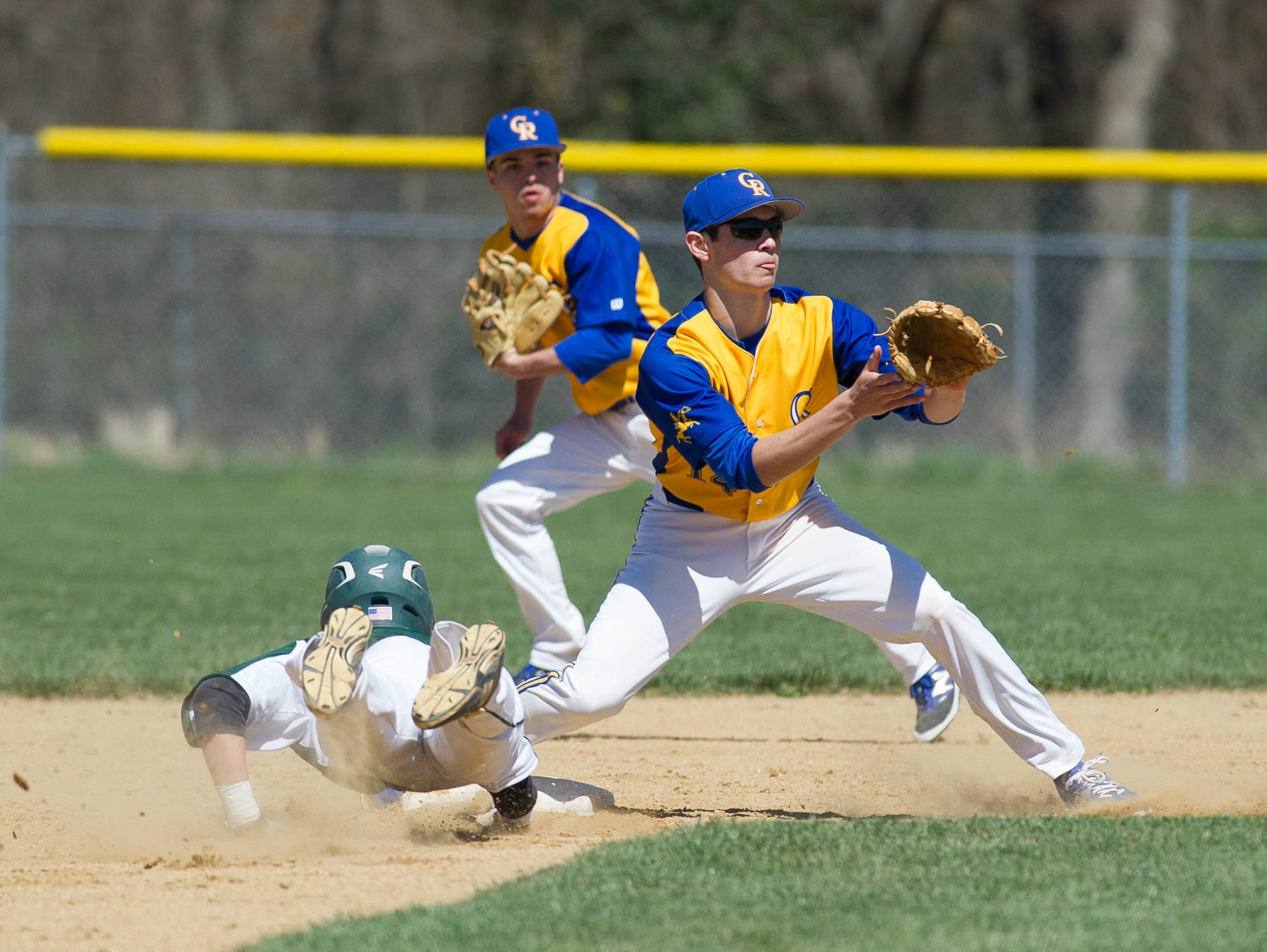 St. Mark's Brian Gilardi (1) slides safely into second base as Caesar Rodney's Thomas Pomatto (14) tries to tag him out.