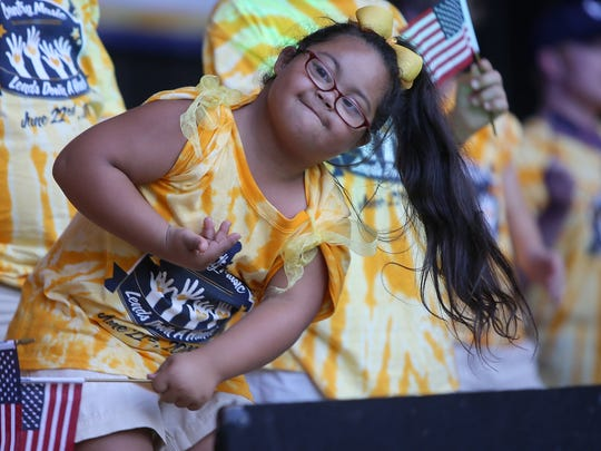 Karsyn Williams bows after performing during the fourth annual Country Music Lends Down a Hand concert at the Casey Jones Village Amphitheatre on Wednesday, June 22, 2016.