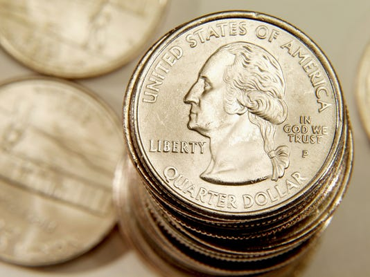 U.S. currency : stack of quarter dollars
