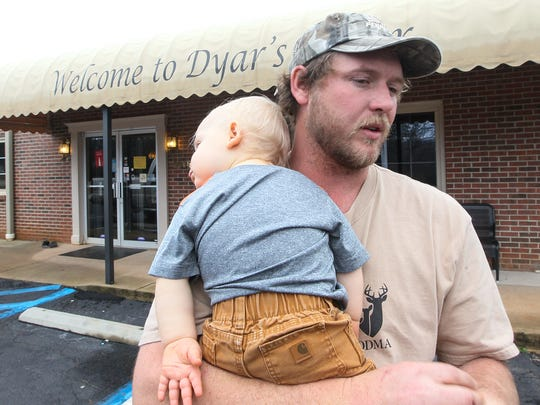 WIll Moore, nephew of the late Tim Dyar of Pendleton, holds his son E.C. Moore on Friday at Dyar's Diner in Pendleton. Moore talks about his late uncle Tim Dyar, the times he worked with him, what he meant to the Pendleton area and his commitment to his church.