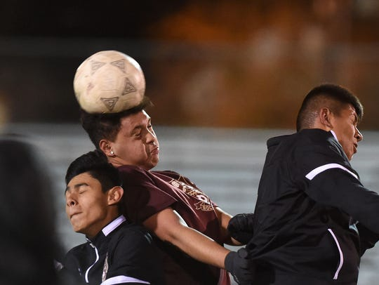 Sparks High soccer players practice on Tuesday. The