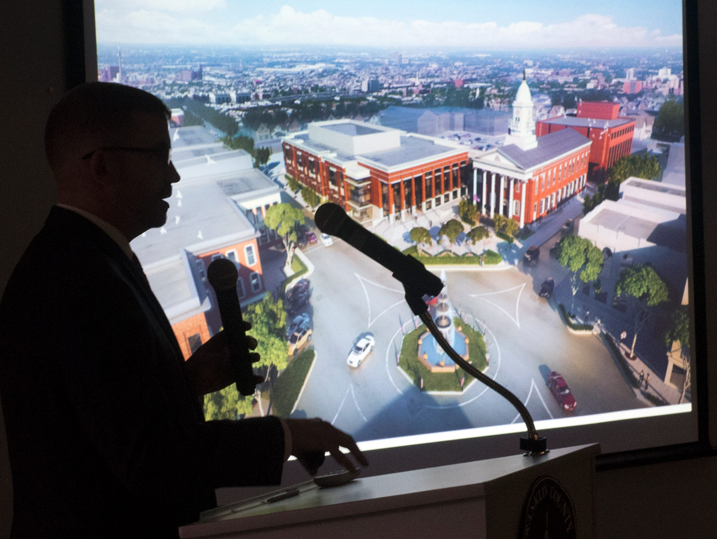 Jody Driggs, of Silling Architects, Charleston, W.V., is silhouetted as he presents proposals during a meeting to discuss the future of the Franklin County Courthouse on Wednesday, January 3, 2018 at the county annex building.