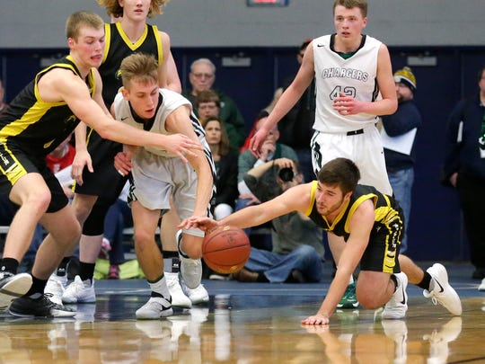 Waupun High School boys basketball's Marcus Domask and Jak Lenz go after a loose ball against Kettle Moraine Lutheran Saturday March 10, 2018 at the WIAA Division 3 sectional finals game in Whitefish Bay. KML won the game 53-48. Doug Raflik/USA TODAY NETWORK-Wisconsin