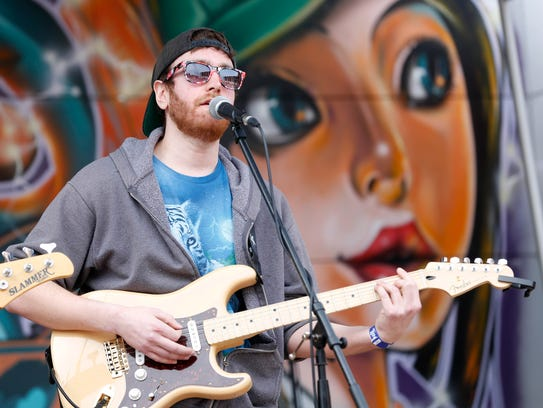 Joey Lyons performs with the Des Moines-based band The Fuss Saturday, May 7, 2016, during the Food Truck Throwdown at the Des Moines Social Club in downtown Des Moines.