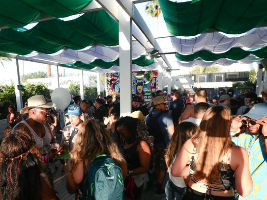 Festival goers on the porch at Heineken House at Coachella