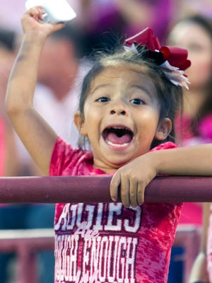 Alyssa Trejo, 4 , of Las Cruces celebrates an interception by the Aggies in the first quarter against Georgia Southern Saturday night at Aggie Memorial Stadium 10/22/16