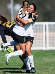 Anderson University's Alaina Gay celebrates with teammate Anderson University's Emily Perez after scoring the first and only goal of the game during the AU doubleheader against Mars Hill on Saturday, October 29, 2016 in Anderson.