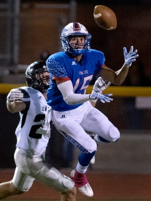 Las Cruces defensive back Brandon Baeza steps in front of Onate wide receiver Monroe Young for the interception Friday night at the Field of Dreams.
