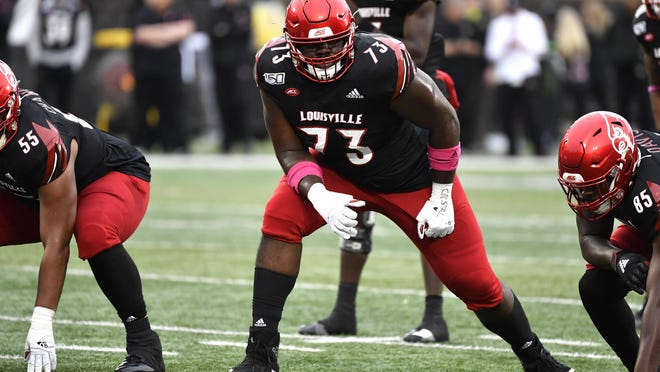 Louisville offensive lineman Mekhi Becton (73) was the Jets' No. 1 pick in the 2020 NFL Draft. Becton has two major goals this season: start from day one and lead the Jets to the playoffs. AP Photo/Timothy D. Easley