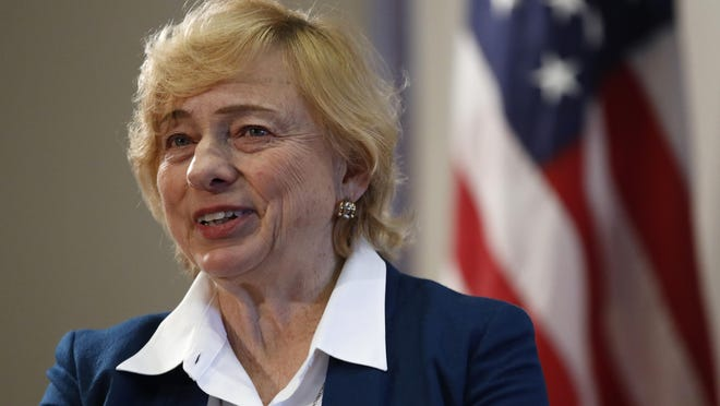 Gov. Janet Mills speaks to reporters before signing papers to posthumously pardon Don Gellers, a Passamaquoddy tribal lawyer convicted of marijuana possession, Tuesday, Jan. 7, 2020, at the Statehouse in Augusta, Maine.