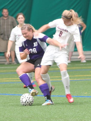 Cleary University's Taylor Richardson jockeys for position against Bluffton at the Legacy Center on Sunday. She scored twice in the final nine minutes to lift the Cougars to a 2-1 win. It was the first of the season for Cleary.