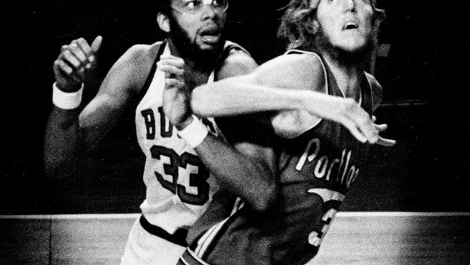 """Bill Walton, 6' 11"""" rookie of the Portland Trail Blazers, maneuvers for position, attempting to block out 7' 2"""" center Kareem Abdul-Jabbar of the Milwaukee Bucks in their game at Milwaukee, Wisc., Jan. 19, 1975. Abdul-Jabbar, who totaled 50 points, overshadowed Walton, who had seven points. The Bucks won 122-108. (AP Photo)"""