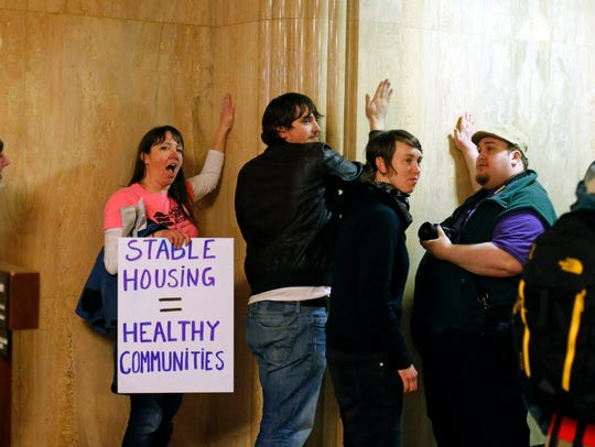 Protesters pound on the walls outside of the House
